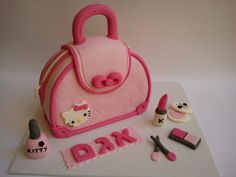 Purse and make up cake at a Hello Kitty #hellokitty #partycake