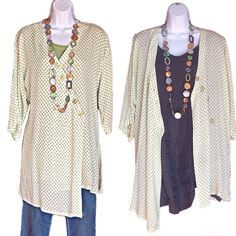 """Long Asymmetrical Polka Dot Blouse Blouse with 3/4-sleeves and green on white polka dots; slits on both sides and three bottoms on the sleeves. Size tag says """"small"""" but it fits more like a medium to large. Very roomy cut. 100 % viscose. Tops Blouses"""