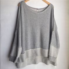 """Free People Oversized and very cute with shoulder slits. Worn once and washed. In EUC. Does run big. No lint or fuzz. Approx. measurements: 19"""" from crew neck to bottom in front. Back 24"""" top to bottom. Across chest approx 30"""". 66% Cotton. 22% Polyester. 12% Rayon. Retail $74. Sold out. Free People Tops Sweatshirts & Hoodies"""