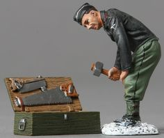 World War II German Army SS048B Tanker with Tool Chest Normandy Version - Made by Thomas Gunn Military Miniatures and Models. Factory made, hand assembled, painted and boxed in a padded decorative box. Excellent gift for the enthusiast.