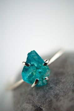 Rough gemstone ring, sterling silver, aqua blue apatite, claw setting by GossamerScapes on Etsy https://www.etsy.com/listing/182484225/rough-gemstone-ring-sterling-silver-aqua