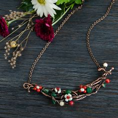 Twig necklace with red flowers