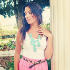 neon pink skirt, white tank, skinny animal print belt and bubble necklace