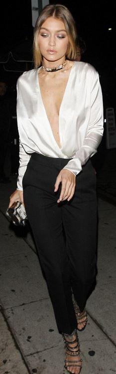 Gigi Hadid: Shoes – Giuseppe Zanotti  Purse -Emm Kou  Pants – Elie Saab  Necklace- Jennifer Fisher