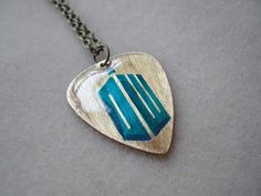 Doctor Who Guitar Pick Necklace - mcloveinstyle Guitar Pick Necklace, Dog Tag Necklace, Diy Jewelry, Jewelery, Jewelry Design, Doctor Who Logo, Doctor Who Jewelry, Guitar Picks, Music Stuff