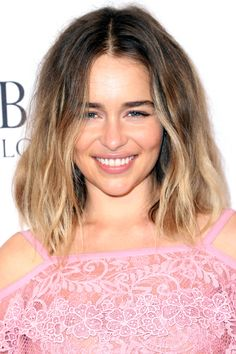 Emilia Clarke with a casual middle part and mussed lob