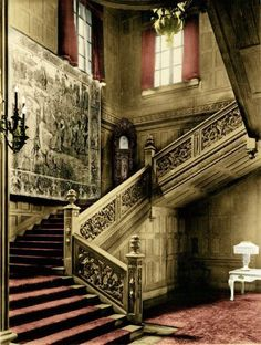 Fabulous ornate staircase with huge tapestry.