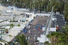 Investigators scoured the Promenade des Anglais and mourners gathered at memorials a day after dozens of people were killed by a truck attack in Nice, France.