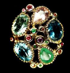 Silver ring with natural rocks: aquamarine, rose emerald, emerald, blue topaz, London blue topaz, multicolored sapphires. Rocks are from Brazil, Zambia, Kenya 205$