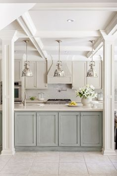 white and pale turquoise cabinets. love this!