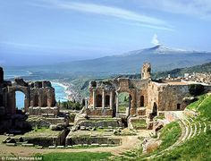 Mount Etna skulks in the distance behind the Sicilian outpost of Taormina.  We went to Taormina in 2007!
