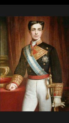 (Miguel Blasco Grupo 2) Pintura del rey Alfonso XII hecha en su juventud, en la cual se puede apreciar el uniforme militar y las condecoraciones asignadas al máximo rango del mismo.