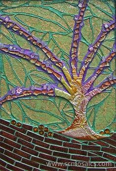 Made of handmade polymer clay tile, tempered glass, millefiore, textured glass, and ceramic tile.