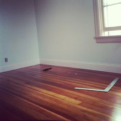 We discovered original wood flooring under the carpet! After restoring it, this is what the boys' room looks like!  #roomandboard #yolocolorhouse #annies