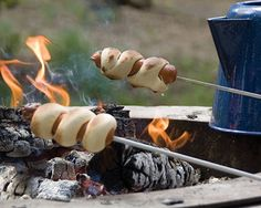 Campfire Twirly Dogs are an exciting new twist to the ol' weenie roast and a great addition to any July 4th celebration.