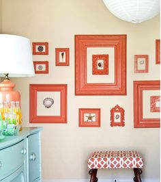orange gallery wall - love this ... and that aqua dresser!