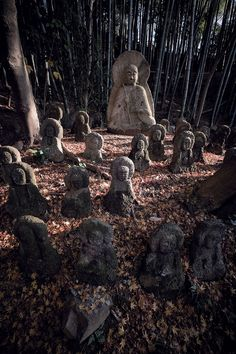 Five hundred Rakan stone statues designed by the Japanese artist Ito Jakuchu decorate the bamboo grove at Sekihoji Temple in Kyoto.