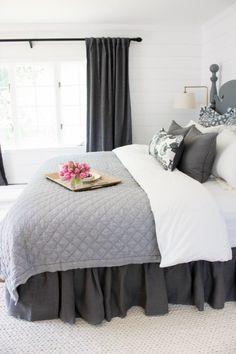 Love the ruffled bedskirt used in this master bedroom makeover