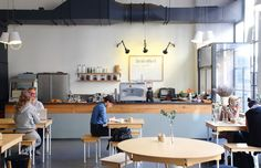 """Pedersen and Lennard crafted everything in the space, from the furniture to the bar counter to the cake stands and food boards. """"The concept is a meeting place of well-designed furniture and good artisan coffee,"""" Pedersen says. """"It's an inspiring space and gives people a chance to get some work done outside of their usual office or home. We offer free WiFi, which we think should be a standard wherever you go by now and serve good coffee."""""""