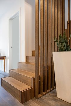 The task: transform an outdated, monotonous interior space into a series of well integrated, light filled and warm areas. Home Stairs Design, Railing Design, House Design, Staircase Design Modern, Escalier Art, Staircase Lighting Ideas, Room Partition Designs, Modern Stairs, House Stairs