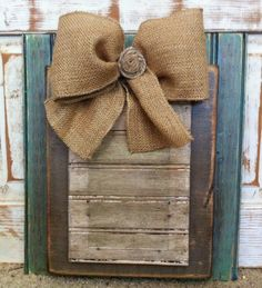 Handmade wooden 4x6 picture frame with burlap bow. $39.00, via Etsy.