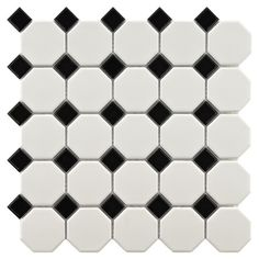 Perfect as a backsplash in the kitchen or powder room, this stylish porcelain tile showcases a matte white hexagon motif accented by glossy black diamonds.
