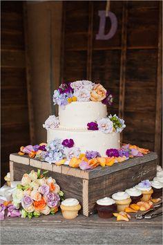 peach and purple wedding cake by Mazzettis Bakery