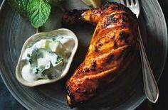 Tandoori chicken A great British favourite, this Indian tandoori chicken is very tasty and spicy and easy to cook. It is accompanied with a yogurt dip and Peshwari naan bread.
