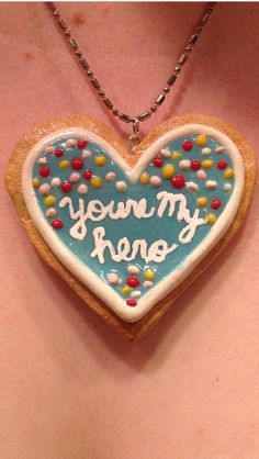 Wreck It Ralph inspired cookie medal necklace made from polymer clay and painted with acrylic paints