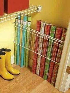 Keep wrapping paper tidy using a piece of shelving in the corner of a closet. Genius!