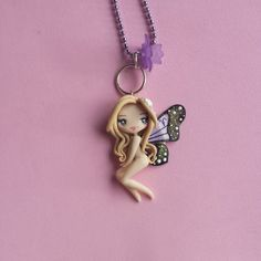 Butterfly necklace sign aries in fimo polymer clay by Artmary2