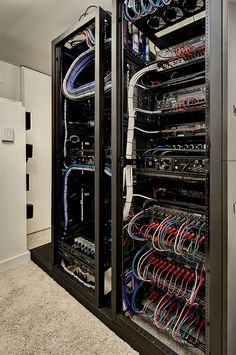 Easy to get to tech room electronic rack system at the New American Home 2012 for the International Builder's Show.