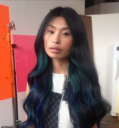 Oil Slick Is the Rainbow Hair Technique Brunettes Can Wear: Everywhere you look this Summer, blondes have been sporting colorful hair shades — pastel pinks, vibrant blues, and even gray.
