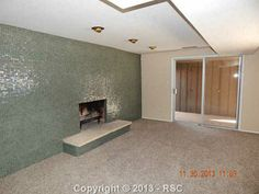 2606 Andromeda Dr, Colorado Springs, CO 80906 (MLS # 788739)- LOVE this fireplace! I wish they wouldn't have updated the rest of the house and left the 1960s beauty