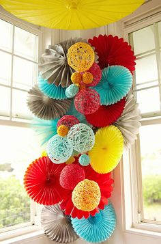 Great Color scheme for an elementary classroom - Fun, bright colors but can be muted when needed. How they are hanging but instead of those thick twine balls we can use our tissue paper pom poms Paper Crafts, Diy Crafts, Decor Crafts, Diy Paper, Festa Party, Party Party, Yarn Ball, Diy Décoration, Paper Decorations