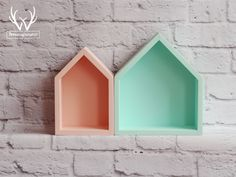 Cute set of peachy and mint house-shaped shelves.