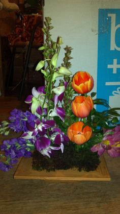 Modern arrangements By The Little Shop Of Flowers In Stillwater, Ok For Information call 405-372-1200
