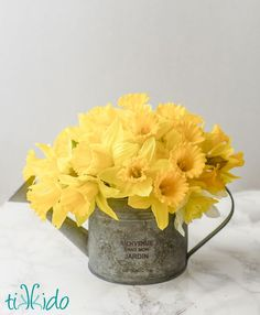 What do you do when a floral container isn't actually watertight?  Here's an incredibly easy work-around that let me make this spring daffodil centerpiece in just minutes.
