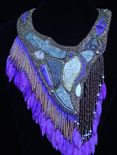 OMG Now this is beadwork! Beautiful designer... Love the addition of the chick twist leather into her designs along with full stones..