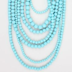 "As seen on ShopDesignSpark.com      -7 Layers of acrylic turquoise beads.  -15-19""L with 3"" extender. Lobster clasp.  -Imported"