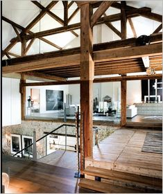 modern & rustic. exposed beams, wire balcony, glass, clean walls, old floors. and on and on.