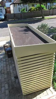 We now have to accommodate three large wheelie bins in our front gardens in Barnet and rather than have to look at them every day I set about designing a stora Bin Store Garden, Bin Shed, Backyard Garden Landscape, Gravel Garden, Garden Oasis, Garden Pond, Terrace Garden, Garden Beds, Front Gardens