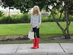 Hearts sweater, jeans & red hunter rain boots.
