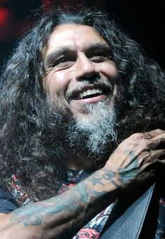 """This is Tom Araya. The lead singer, bassist, and songwriter of the famous Thrash Metal band """"Slayer"""" His band is also in a thrash group called """"The Big Four"""". Involving: Anthrax, Metallica, Slayer, and Megadeth."""