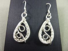 Non-tarnish silver wire frame, wrapped, embellished, coiled and finished with sterling silver earwires. Tarnished Silver, Sterling Silver, Wire Wrapped Earrings, Drop Earrings, Wire Frame, Wire Wrapping, Jewelry, Jewlery, Jewels