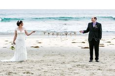 "The newlyweds display their ""twoo wuv"" banner in front of the waves 