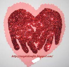 Valentine craft...heart glitter handprint