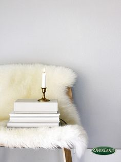 Place a furry rug over a modern piece of furniture to give it a softer feel.