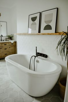 Modern Eclectic Bathroom Remodel - House On Longwood Lane Eclectic Bathroom, Modern Bathroom, Master Bathroom, Vanity Bathroom, Bathroom Hardware, Bathroom Tubs, Bath Tub, Bathroom Ideas, Bathroom Artwork