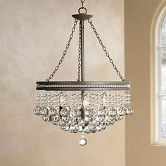 The refined appeal of this chandelier is clear, thanks to a cascade of clear crystal baubles that sparkle when illuminated. A trim of small crystal accents adds extra glamour.